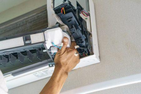 service-technician-is-cleaning-repair-maintenance-air-conditioner | handyman in dubai | Hnadyman services in dubai
